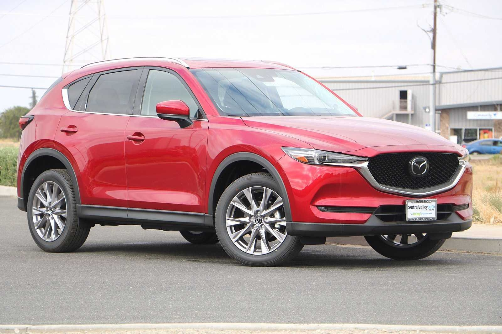 New 2019<br>Mazda CX-5<br>Grand Touring With Navigation & AWD